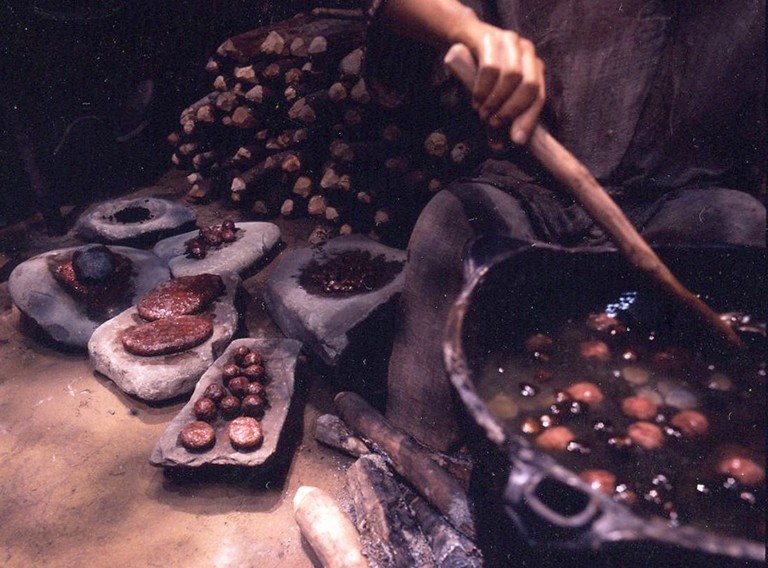Fig. 14 - A reconstruction of cooking Jomon dumplings, like those found carbonised at Ondashi, Yamagata prefecture