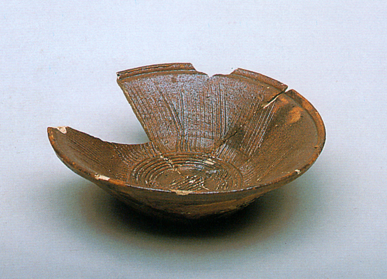 Fig. 18 - Earthenware mortar from Naito-cho