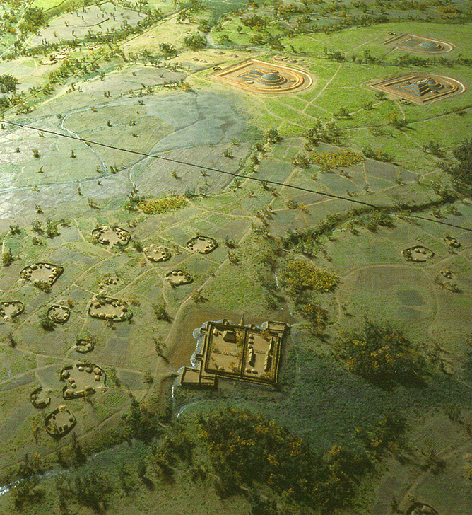 Fig. 06 - An overview of the landscape around the Mitsudera 1 elite residential enclosure (lower centre), with surrounding farmsteads and a group of large keyhole shaped burial mounds (kofun) at the top.