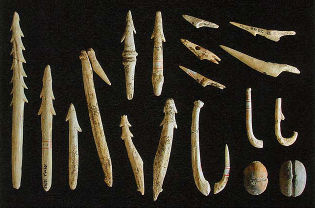 Fig. 10 - Jomon fishing gear Top right: five head-removable harpoons. Left: normal harpoons. Bottom right: fish hooks and net sinkers