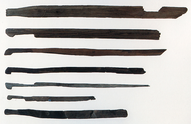 Fig. 11 - Sword-shaped wooden artefacts from Mitsudera 1, Gunma prefecture. Lowest: length 55 cms