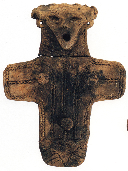 Fig. 10 - Large cruciform dogu from' in front of 'Sannai Maruyama' and ', c. 1500-1000 BC. Height 32 centimetres.' after 'Jomon