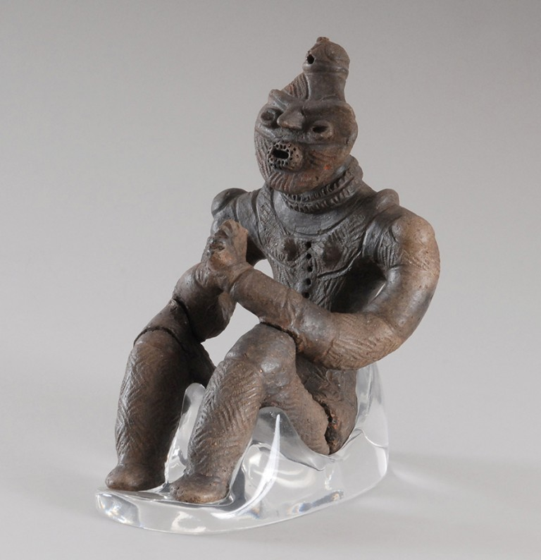 Fig. 11 - Seated dogu with clasped hands from Kazahari, Aomori prefecture. Late Jomon, c. 1500-1000 BC. National Treasure. Height 19.8 centimetres