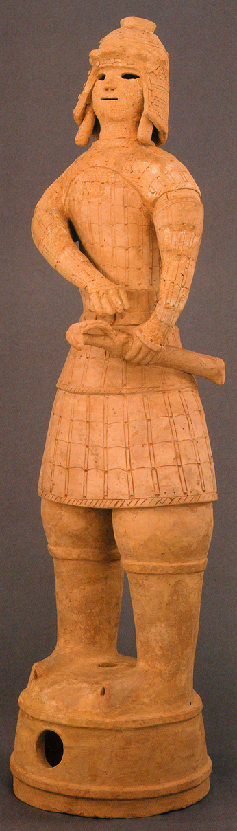 Fig. 14 - An armoured warrior haniwa from Imashirozuka-kofun, Osaka prefecture, of the Late Kofun period (6th century). Height 118 cms