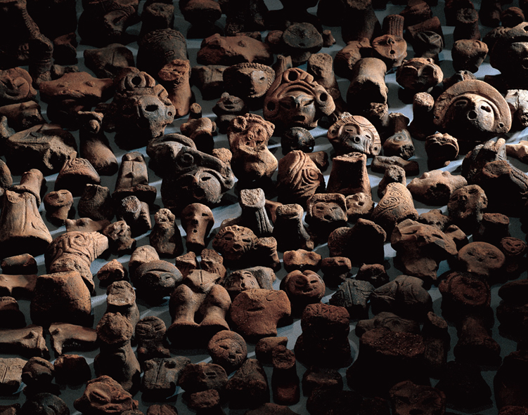 Fig. 08 - Some of the 1116 dogu fragments from Shakado, Yamanashi prefecture. Middle Jomon, c. 2500-1500 BC.