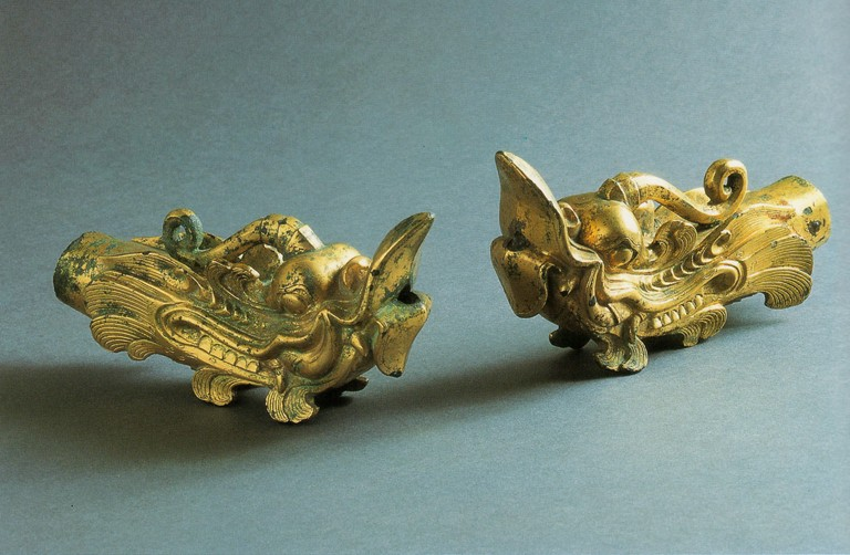 Fig. 19 - Dragonhead ornaments from Okinoshima